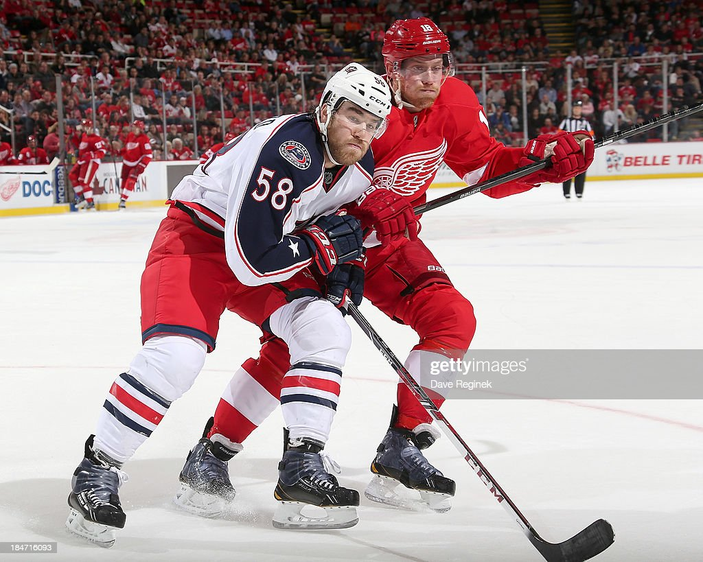<a gi-track='captionPersonalityLinkClicked' href=/galleries/search?phrase=David+Savard&family=editorial&specificpeople=4630692 ng-click='$event.stopPropagation()'>David Savard</a> #58 of the Columbus Blue Jackets and Joakim Andersson #18 of the Detroit Red Wings battle for position during a NHL game at Joe Louis Arena on October 15, 2013 in Detroit, Michigan.