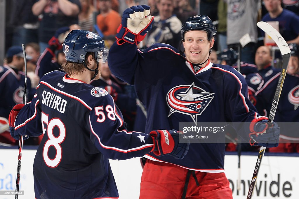 <a gi-track='captionPersonalityLinkClicked' href=/galleries/search?phrase=David+Savard&family=editorial&specificpeople=4630692 ng-click='$event.stopPropagation()'>David Savard</a> #58 of the Columbus Blue Jackets and <a gi-track='captionPersonalityLinkClicked' href=/galleries/search?phrase=Nikita+Nikitin&family=editorial&specificpeople=722107 ng-click='$event.stopPropagation()'>Nikita Nikitin</a> #6 of the Columbus Blue Jackets celebrate after scoring a goal during the third period in a game against the Philadelphia Flyers on December 21, 2013 at Nationwide Arena in Columbus, Ohio. Columbus defeated Philadelphia 6-3.