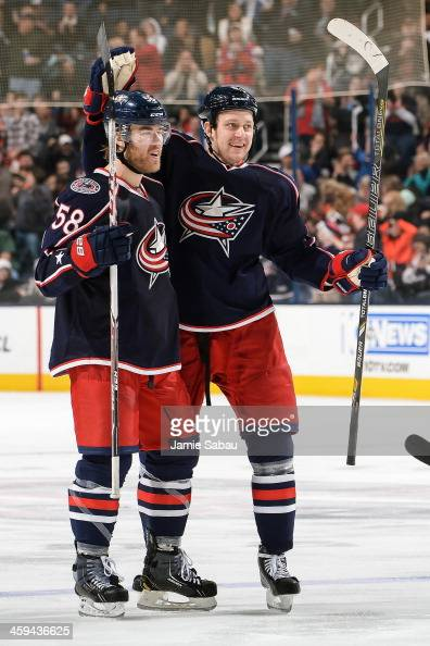 David Savard of the Columbus Blue Jackets and Nikita Nikitin of the Columbus Blue Jackets celebrate a goal against the Philadelphia Flyers on...