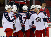David Savard of the Columbus Blue Jackets celebrates the win with teammate Kerby Rychel after the game against the New Jersey Devils on November 25...