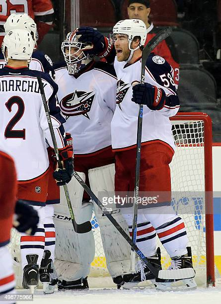 David Savard of the Columbus Blue Jackets celebrates the win with teammate Sergei Bobrovsky after the game against the New Jersey Devils on November...