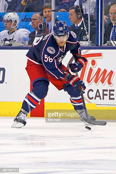 David Savard of the Columbus Blue Jackets controls the puck during Game Six of the First Round of the 2014 NHL Stanley Cup Playoffs against the...