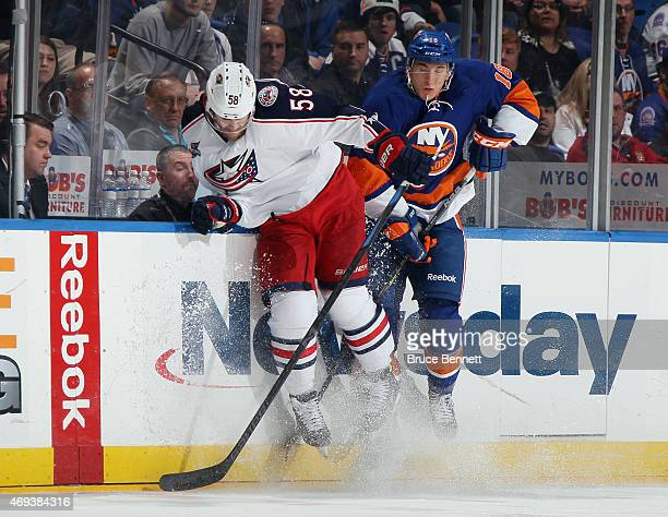 David Savard of the Columbus Blue Jackets hits Ryan Strome of the New York Islanders during the second period at the Nassau Veterans Memorial...