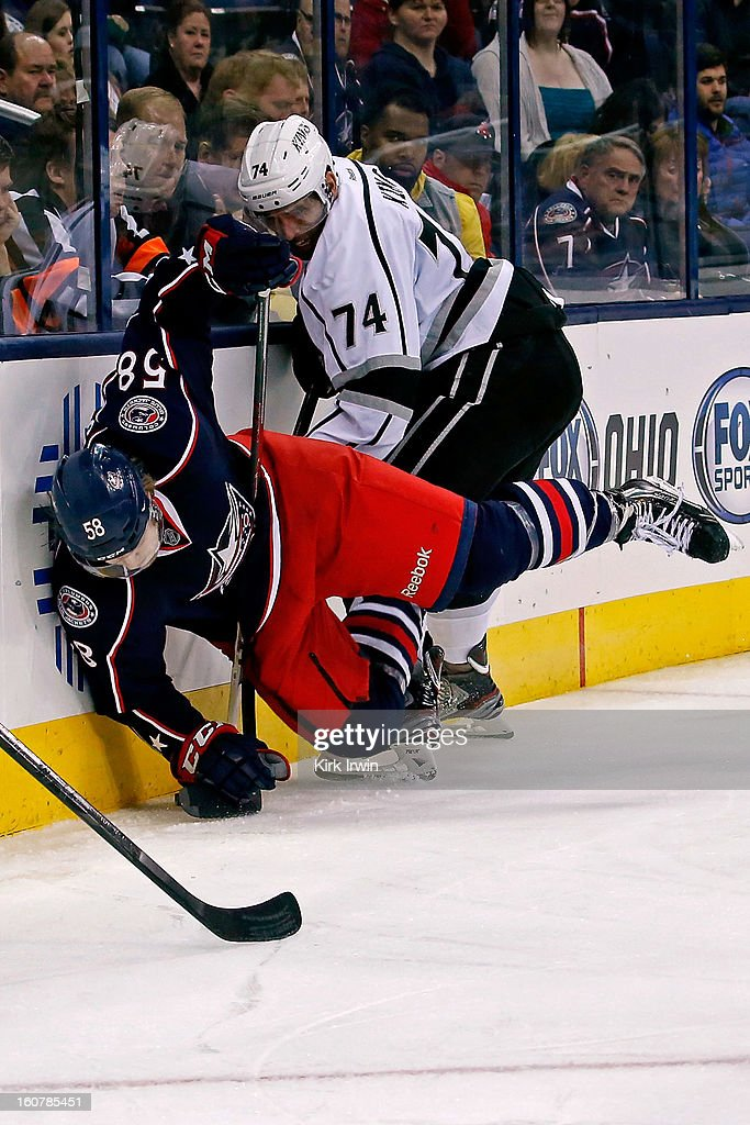 <a gi-track='captionPersonalityLinkClicked' href=/galleries/search?phrase=David+Savard&family=editorial&specificpeople=4630692 ng-click='$event.stopPropagation()'>David Savard</a> #58 of the Columbus Blue Jackets is checked into the boards by <a gi-track='captionPersonalityLinkClicked' href=/galleries/search?phrase=Dwight+King+-+Ice+Hockey+Player&family=editorial&specificpeople=4537297 ng-click='$event.stopPropagation()'>Dwight King</a> #74 of the Los Angeles Kings during the third period on February 5, 2013 at Nationwide Arena in Columbus, Ohio. Los Angeles defeated Columbus 4-2.
