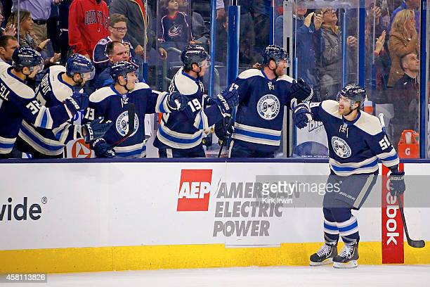 David Savard of the Columbus Blue Jackets is congratulated by his teammates after scoring a goal during the game against the Ottawa Senators on...