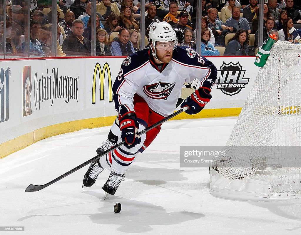 <a gi-track='captionPersonalityLinkClicked' href=/galleries/search?phrase=David+Savard&family=editorial&specificpeople=4630692 ng-click='$event.stopPropagation()'>David Savard</a> #58 of the Columbus Blue Jackets moves the puck against the Pittsburgh Penguins in Game Two of the First Round of the 2014 Stanley Cup Playoffs at Consol Energy Center on April 19, 2014 in Pittsburgh, Pennsylvania.