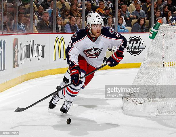 David Savard of the Columbus Blue Jackets moves the puck against the Pittsburgh Penguins in Game Two of the First Round of the 2014 Stanley Cup...