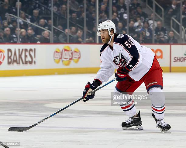 David Savard of the Columbus Blue Jackets plays the puck at the point during first period action against the Winnipeg Jets at the MTS Centre on...