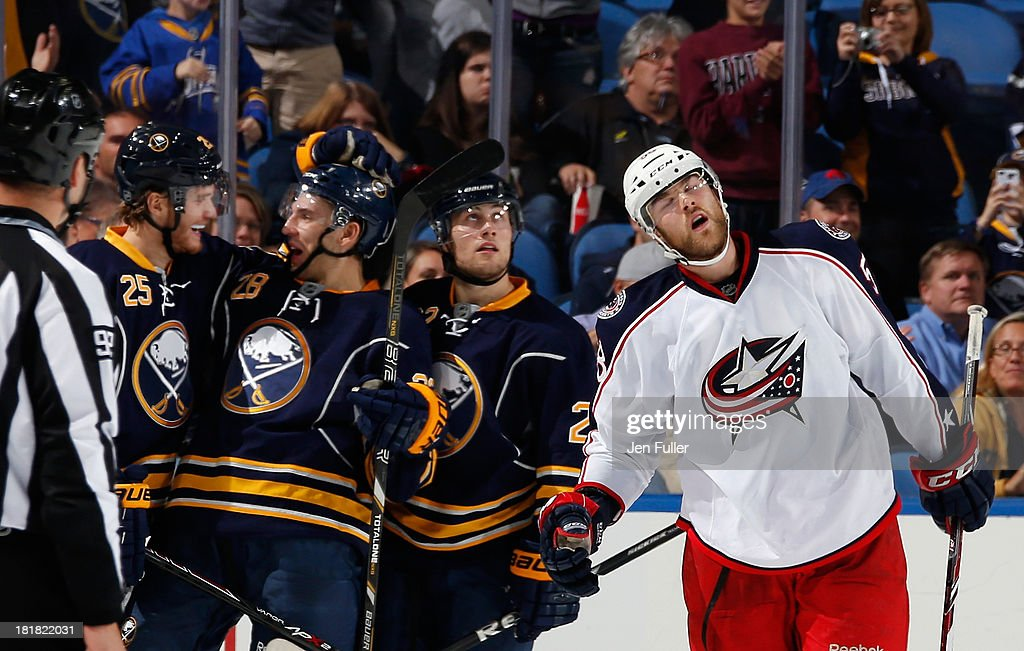 <a gi-track='captionPersonalityLinkClicked' href=/galleries/search?phrase=David+Savard&family=editorial&specificpeople=4630692 ng-click='$event.stopPropagation()'>David Savard</a> #58 of the Columbus Blue Jackets reacts to an empty net goal by <a gi-track='captionPersonalityLinkClicked' href=/galleries/search?phrase=Zemgus+Girgensons&family=editorial&specificpeople=8050732 ng-click='$event.stopPropagation()'>Zemgus Girgensons</a> #28 of the Buffalo Sabres as he celebrates with teammates <a gi-track='captionPersonalityLinkClicked' href=/galleries/search?phrase=Mikhail+Grigorenko&family=editorial&specificpeople=8771251 ng-click='$event.stopPropagation()'>Mikhail Grigorenko</a> #25 and Johan Larsson #22 during their preseason game at First Niagara Center on September 25, 2013 in Buffalo, New York. Buffalo defeated Columbus, 3-0.