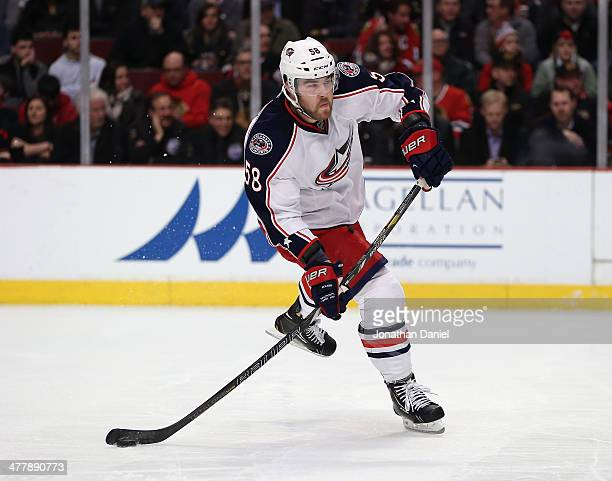 David Savard of the Columbus Blue Jackets skates against the Chicago Blackhawks at the United Center on March 6 2014 in Chicago Illinois The...