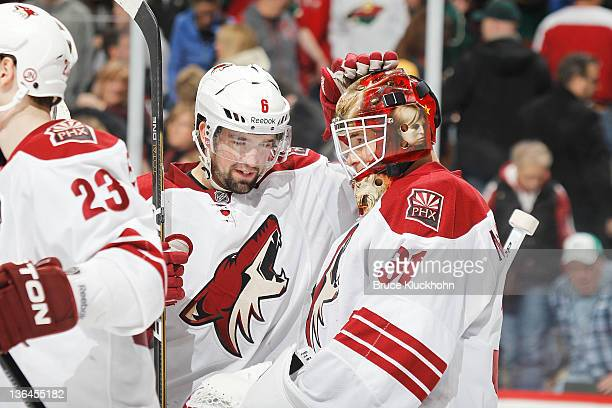 David Schlemko and Curtis McElhinney of the Phoenix Coyotes celebrate after defeating the Minnesota Wild at the Xcel Energy Center on December 31...
