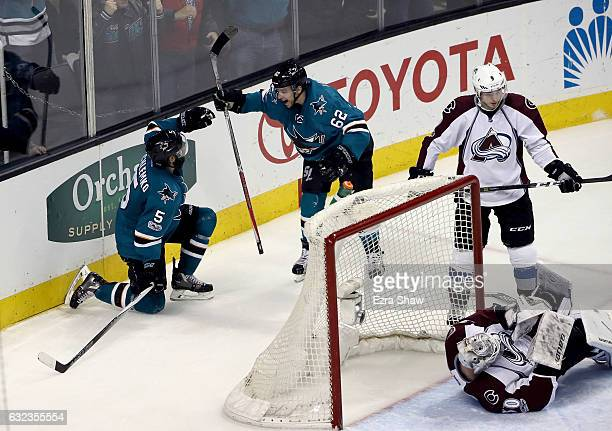 David Schlemko and Kevin Labanc of the San Jose Sharks celebrate after Schlemko scored the gamewinning goal in overtime on Spencer Martin of the...