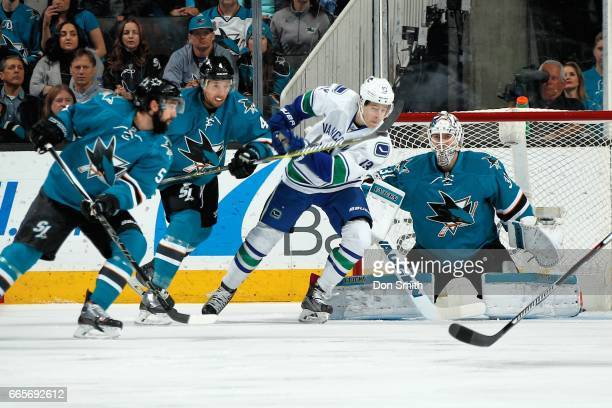 David Schlemko Brenden Dillon and Martin Jones the San Jose Sharks defend against Griffen Molino of the Vancouver Canucks at San Jose on April 4 2017...