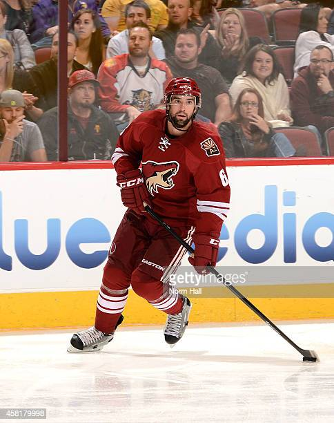 David Schlemko of the Arizona Coyotes skates the puck up ice against the Florida Panthers at Gila River Arena on October 25 2014 in Glendale Arizona