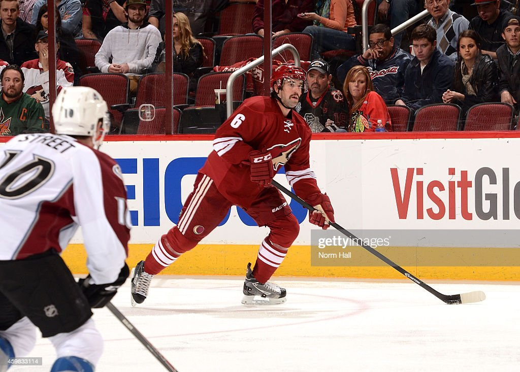 David Schlemko of the Arizona Coyotes skates with the puck against the Colorado Avalanche at Gila River Arena on November 25 2014 in Glendale Arizona