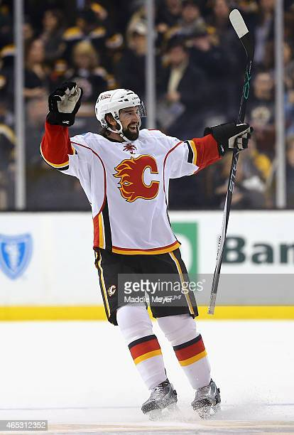 David Schlemko of the Calgary Flames is celebrates after scoring the game winning goal during a shootout against the Boston Bruins at TD Garden on...