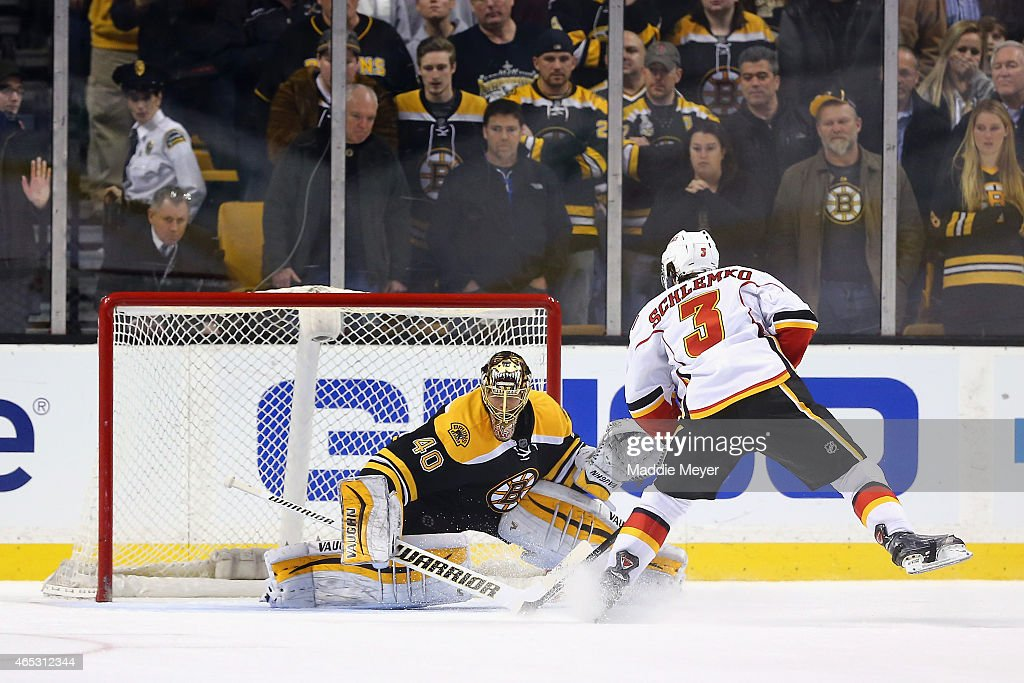 David Schlemko of the Calgary Flames takes a shot against Tuukka Rask of the Boston Bruins at TD Garden on March 5 2015 in Boston Massachusetts The...