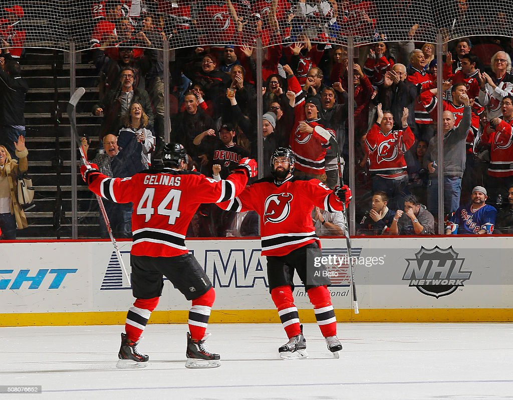 David Schlemko of the New Jersey Devils celebrates scoring the go ahead goal against the New York Rangers with Eric Gelinas during their game at the...