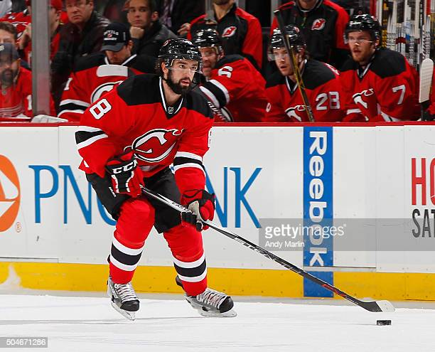 David Schlemko of the New Jersey Devils controls the puck during the game against the Detroit Red Wings at the Prudential Center on January 4 2016 in...