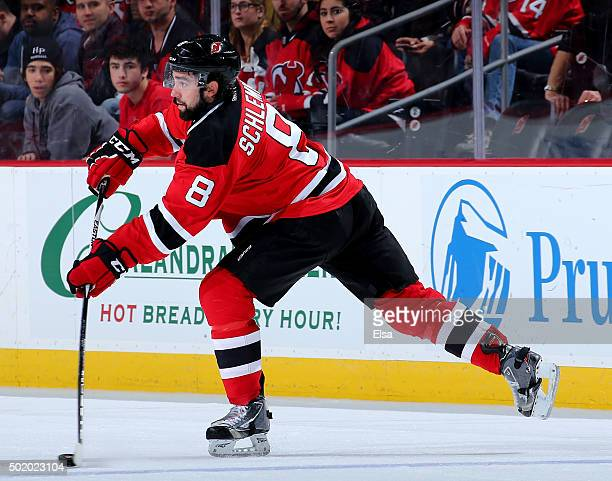 David Schlemko of the New Jersey Devils passes the puck in the third period against the Anaheim Ducks on December 19 2015 at Prudential Center in...