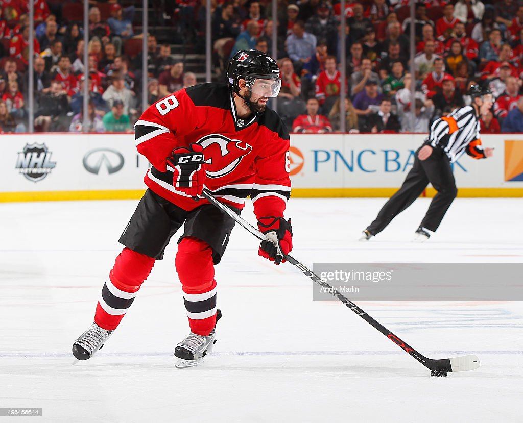 David Schlemko of the New Jersey Devils plays the puck against the Chicago Blackhawks during the game at the Prudential Center on November 6 2015 in...