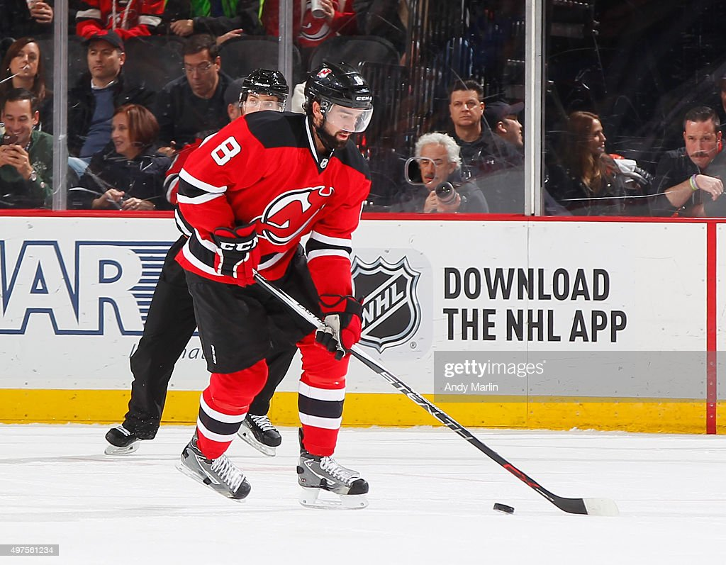 David Schlemko of the New Jersey Devils plays the puck during the game against the Pittsburgh Penguins at the Prudential Center on November 14 2015...