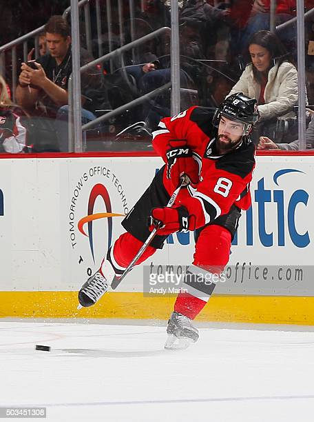 David Schlemko of the New Jersey Devils plays the puck during the game against the Dallas Stars at the Prudential Center on January 2 2016 in Newark...