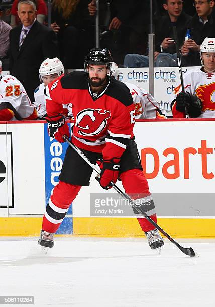 David Schlemko of the New Jersey Devils plays the puck during the game against the Calgary Flames at the Prudential Center on January 19 2016 in...
