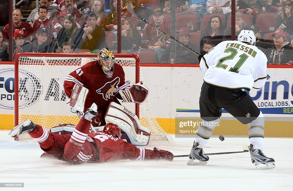 David Schlemko #6 of the Phoenix Coyotes dives to block the shot of Loui Eriksson #21 of the Dallas Stars as Coyotes goalie Mike Smith #41 stands ready during the first period at Jobing.com Arena on February 2, 2013 in Glendale, Arizona.