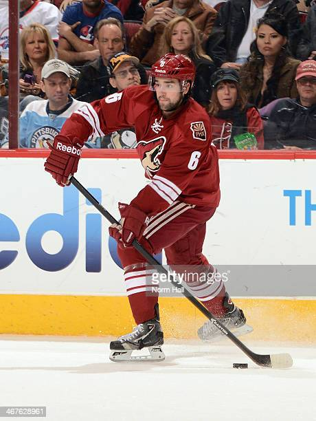David Schlemko of the Phoenix Coyotes passes the puck against the Pittsburgh Penguins at Jobingcom Arena on February 1 2014 in Glendale Arizona