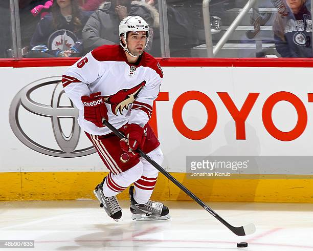 David Schlemko of the Phoenix Coyotes plays the puck up the ice during third period action against the Winnipeg Jets at the MTS Centre on January 13...
