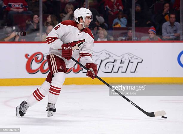 David Schlemko of the Phoenix Coyotes skates with the puck against the Montreal Canadiens during the NHL game on December 17 2013 at the Bell Centre...