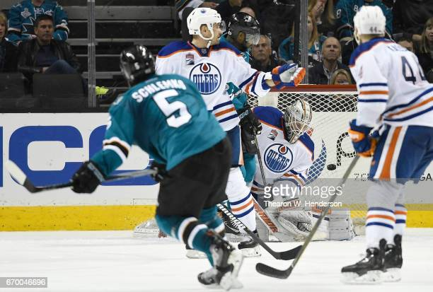 David Schlemko of the San Jose Sharks scores a goal getting his shot past goalie Laurent Brossoit of the Edmonton Oilers during the third period in...