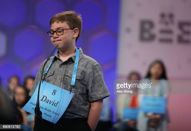 David Scot Firestone of Palm City Florida reacts after he misspelled his word during round two of 2017 Scripps National Spelling Bee at Gaylord...