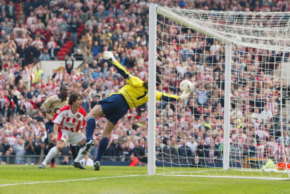 David Seaman of Arsenal makes a spectacular save to keep the ball out : News Photo