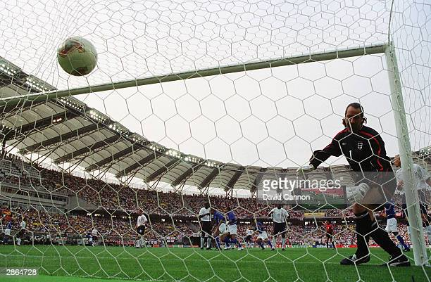 David Seaman of England can only watch in horror as an amazing freekick from Ronaldinho of Brazil goes in to the net for the winning goal during the...