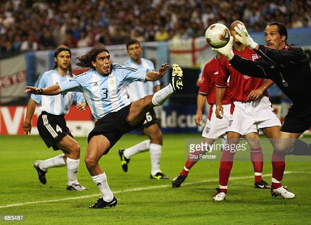 David Seaman of England dives to save from Juan Sorin of Argentina during the Group F match at the World Cup Group Stage played at the Sapporo Dome...