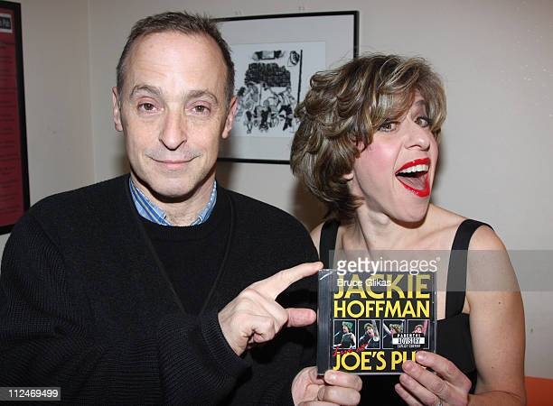 David Sedaris and Jackie Hoffman pose backstage at 'Jackie Hoffman in Scraping The Bottom Holiday Edition' at Joe's Pub on December 8 2008 in New...