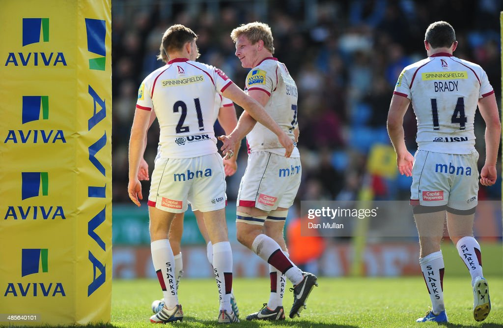 David Seymour of Sale Sharks (C) celebrates scoring a try with Will Cliff of Sale Sharks (L) during the Aviva Premiership match between Exeter Chiefs and Sale Sharks at Sandy Park on April 19, 2014 in Exeter, England.