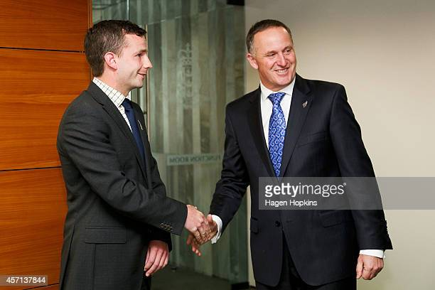 David Seymour shakes hands with Prime Minister John Key before his appointment as a Parliamentary UnderSecretary at The Beehive on October 13 2014 in...