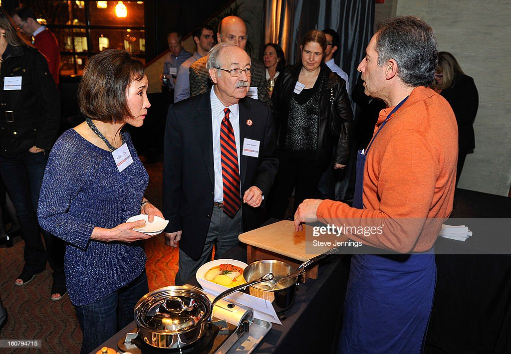 David Shalleck (R) fine dining chef cooks for the crowd at the Syracuse University's San Francisco Donor Reception at Waterbar Restaurant on February 5, 2013 in San Francisco, California.
