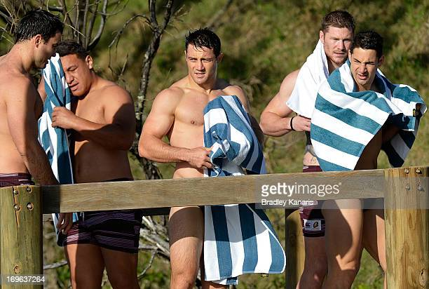 David Shillington Josh Papalii Cooper Cronk Chris McQueen and Billy Slater dry themselves after an early morning swim at the beach during a...