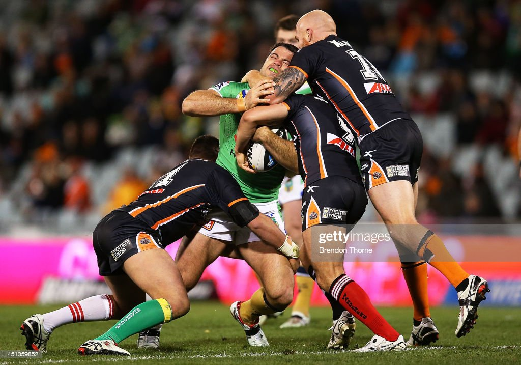 David Shillington of the Raiders is tackled by the Tigers defence during the round 16 NRL match between the Wests Tigers and the Canberra Raiders at Campbelltown Sports Stadium on June 28, 2014 in Sydney, Australia.