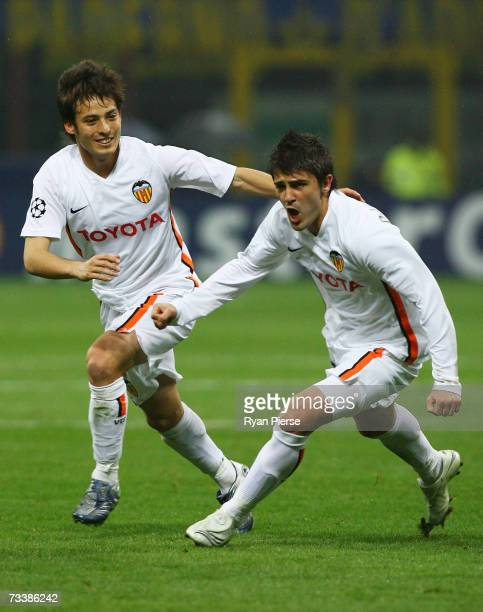 David Silva and David Villa of Valencia celebrate after Villa scored his teams first goal during the UEFA Champions League Round of 16 first leg...