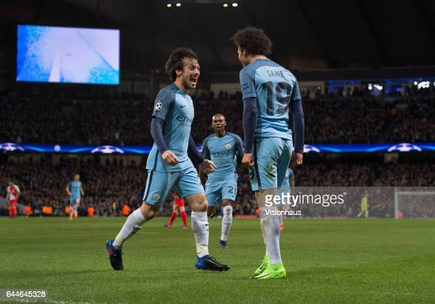 David Silva and Leroy Sane of Manchester City celebrate the first goal during the UEFA Champions League Round of 16 first leg match between...