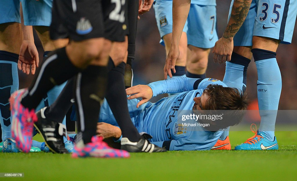 <a gi-track='captionPersonalityLinkClicked' href=/galleries/search?phrase=David+Silva&family=editorial&specificpeople=675795 ng-click='$event.stopPropagation()'>David Silva</a> of Manchester City after he lies injured after a tackle from <a gi-track='captionPersonalityLinkClicked' href=/galleries/search?phrase=Ryan+Taylor+-+English+Soccer+Midfielder+Born+1984&family=editorial&specificpeople=4606691 ng-click='$event.stopPropagation()'>Ryan Taylor</a> of Newcastle United during the Capital One Cup Fourth Round match between Manchester City and Newcastle United at Etihad Stadium on October 29, 2014 in Manchester, England.