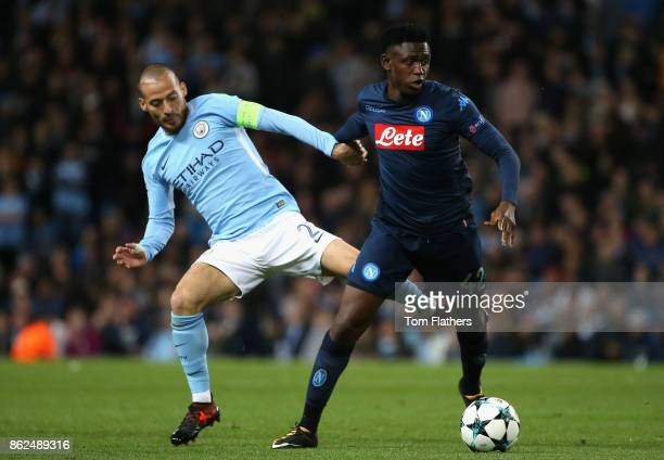 David Silva of Manchester City and Amadou Diawara of SSC Napoli battle for possession during the UEFA Champions League group F match between...