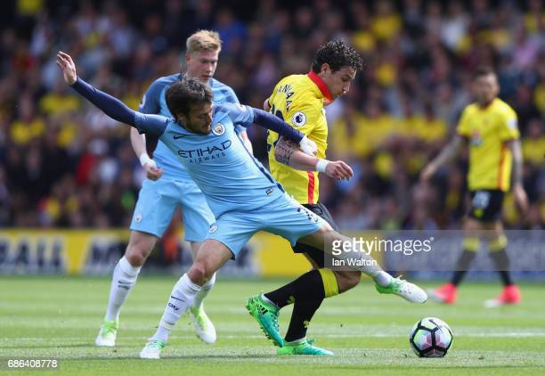 David Silva of Manchester City and Daryl Janmaat of Watford battle for possession during the Premier League match between Watford and Manchester City...