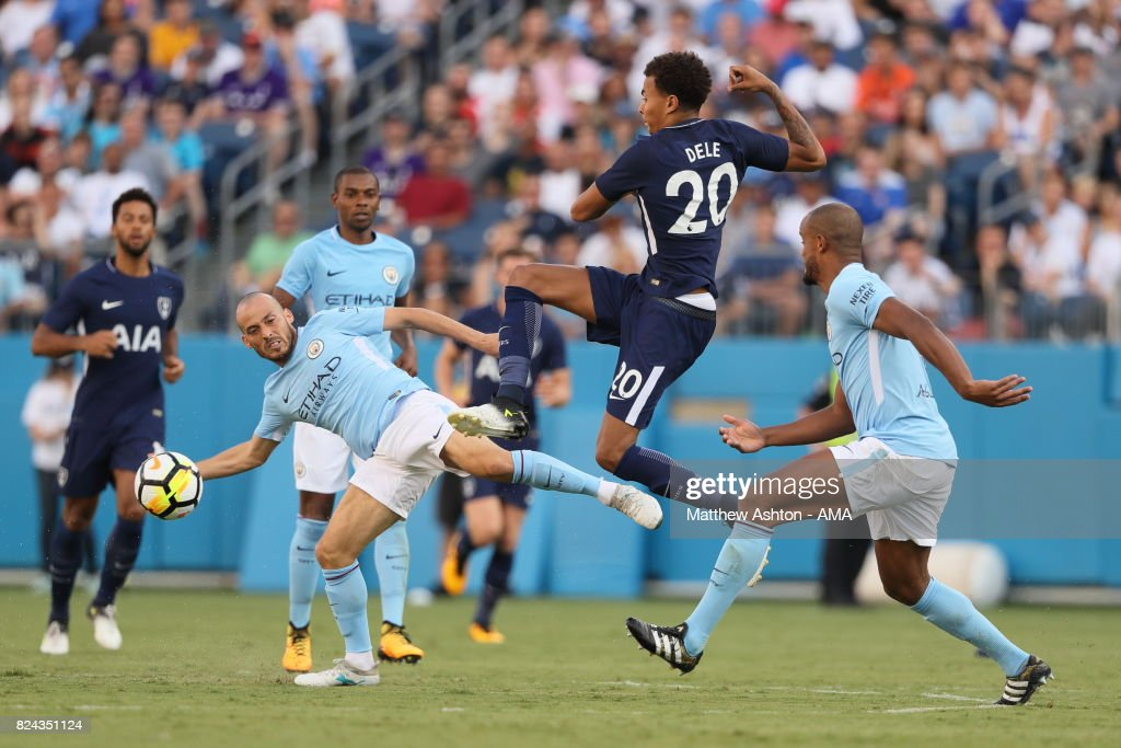 David Silva of Manchester City and Dele Alli of Tottenham Hotspur during the International Champions Cup 2017 match between Manchester City and Tottenham Hotspur at Nissan Stadium on July 29, 2017 in Nashville, Tennessee.