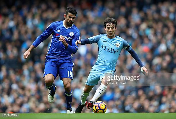 David Silva of Manchester City and Diego Costa of Chelsea compete for the ball during the Premier League match between Manchester City and Chelsea at...
